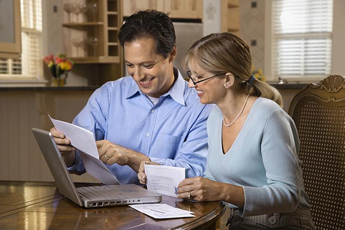 Couple Paying Bills Online